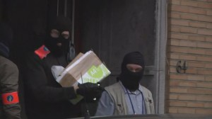 Police raid Brussels apartment, remove boxes, bags