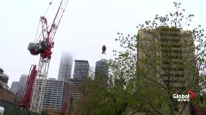 Woman stranded on Toronto crane lowered to ground
