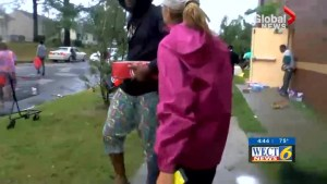 Reporter confronts people looting in aftermath of Tropical Storm Florence on live TV