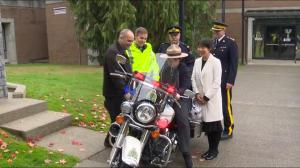 Harley, a young wannabe Mountie, gets to sit on an RCMP Harley