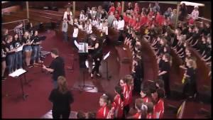 "Elementary school choirs honour Gord Downie by singing ""Ahead By a Century"""