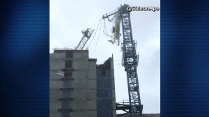 Collapsed crane dangles from Miami building after Hurricane Irma topples it