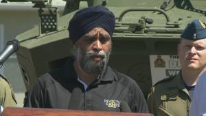 Canada's defence minister tours flood prone areas in the Okanagan and thanks Canadian soldiers for helping out