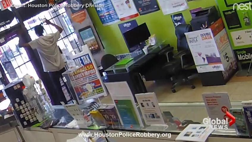 Worker locks armed robber inside cellphone store