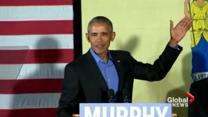 Obama blasts 'old politics of division' day after Bush takes jabs at Trump