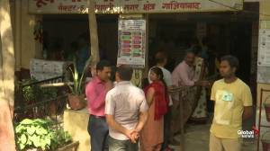People in India line up to cast vote in national elections