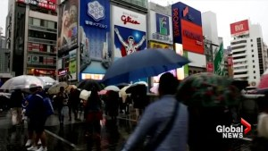 Typhoon drenches Japan as voters turn out for general election day