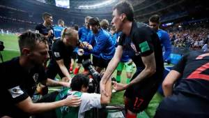 Unlucky World Cup photographer bowled over, buried under goal celebration dog pile