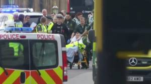 Injured man wheeled to ambulance following incident outside British parliament