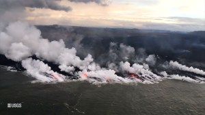 Aerial video captures more lava from Hawaii's Kilauea volcano entering ocean, creating more laze