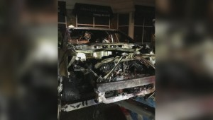 Police officers rescue unconscious driver from burning vehicle