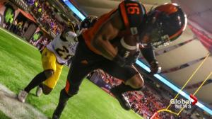 Professional photographer part of the action at BC Lions game
