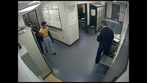 Police video shows murder accused in custody at the police station