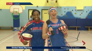 Harlem Globetrotters spin with Kim
