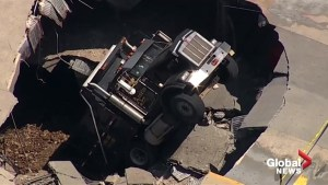 Aerial footage: Dump truck falls through New Jersey parking garage