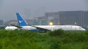 Passenger on airline records as plane skids off runway in the Philippines
