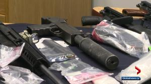 Firearms, drugs, cash seized from Alberta home and storage unit