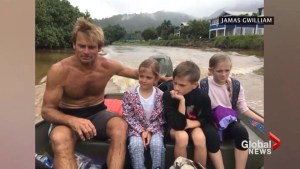 Surfing legend Laird Hamilton helps rescue families from flooding on Hawaiian islands