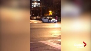 Video shows road rage incident involving man appearing to jump on hood of moving car