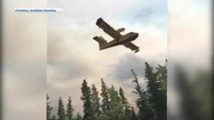 Water bombers fill up on way to fight fire burning near Burns Lake