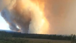 Massive smoke clouds block out sun over 108 Mile House