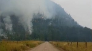 Little Fort resident surveys wildfires as flames move closer