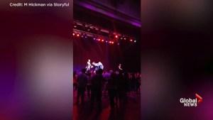 'Color Me Badd' band member arrested after violently shoving band mate on stage during concert