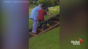 Video captures boy helping elderly woman up steps in Georgia