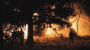 Surrey home in heavily forested area goes up in flames
