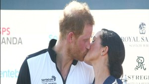 Britain's Prince Harry and Meghan, Duchess of Sussex share kiss at charity polo match