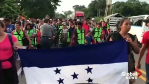 After crossing border from Guatemala to Mexico, thousands of caravan migrants head north