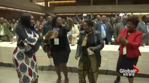Zimbabwe's ruling party members celebrate, dance after former VP reinstated