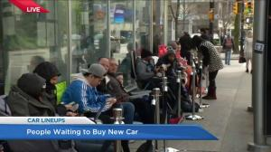 Future Tesla owners line up overnight to pre-order new electric car