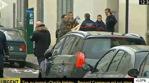 Paris shooting victims carried out of newspaper offices