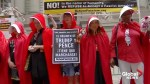 Women dressed as handmaids protest Trump and Pence in New York