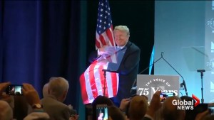 Donald Trump gives big hug to American flag