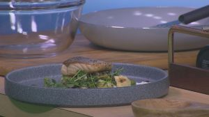 Hotel Saskatchewan executive chef Curtis Toth prepares Chinook salmon