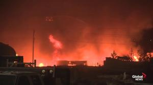 Explosions ring out as large industrial fire rages south of Edmonton