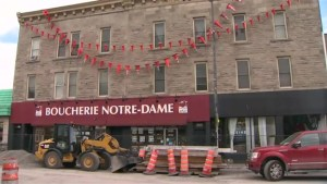 Orange cone garland hangs above Montreal butcher shop