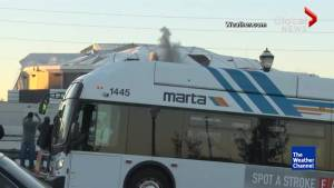 Cameraman reacts to bus blocking Georgia Dome implosion
