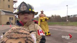 2-year-old firefighter-in-training following in Riverview father's footsteps