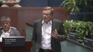 Toronto Mayor John Tory, councillor have heated exchange during debate over cuts to council by Ford government