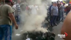 Military Uniforms burned as Venezuelans protest near Columbia border