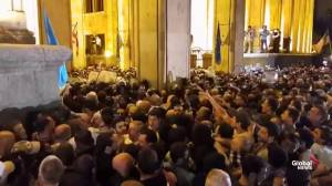Chaotic scenes as protesters storm Georgia's parliament buildings