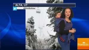 Meteorologist straps baby to her back during broadcast to promote babywearing