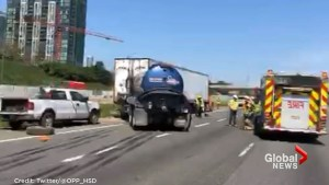 1 dead after truck crashes into parked transport truck on Hwy. 403 in Mississauga: police