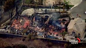 Homes destroyed as southern California wildfires spread