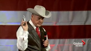 Republican candidate for Senate pulls out gun on stage during campaign event