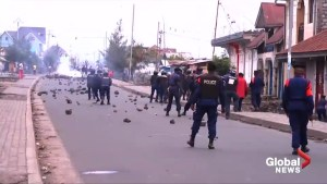 Police in Congo fire tear gas at protesters as election nears