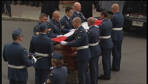 Canadian soldiers fold flag and deliver it to Vincent's family